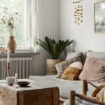 Living Room With Rug, Wooden Box For Coffee Table, Low Bench With Grey Cushion, Pillows, Plants, Lace In Curtains, Bamboo Chair