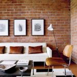 Living Room With Wooden Floor, Black White Rug, Orange Red Open Brick Wall, Wooden Ceiling, White Sofa, Wooden Chair, Black Square Table