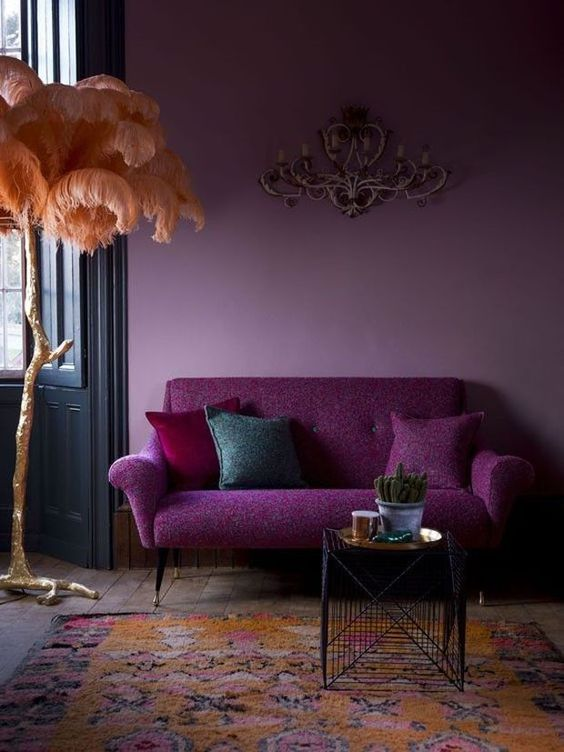 living room with wooden floor, rug, purple sofa, purple wall
