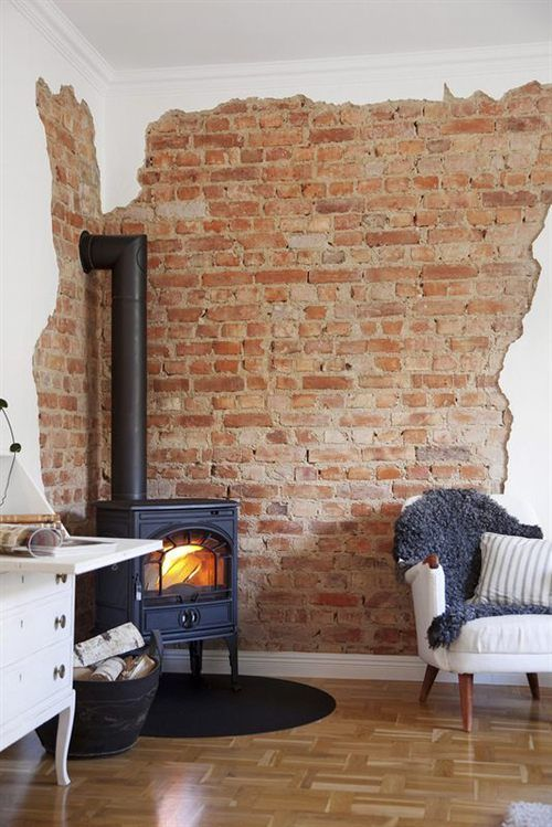 Living Room With Wooden Look Floor White Wall Exposed Brick Fire Furnace