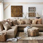 Living Room, Wooden Floor, Rug, Brown Sofa, Pillows, Round Ottoman For Coffee Table, Basket, White Wall, White Curtain, Floor Lamp