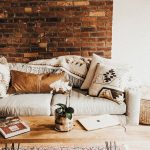 Living Room, Wooden Floor, Rug, Wooden Table With Metal Leg, Open Brick Wall, White Sofa
