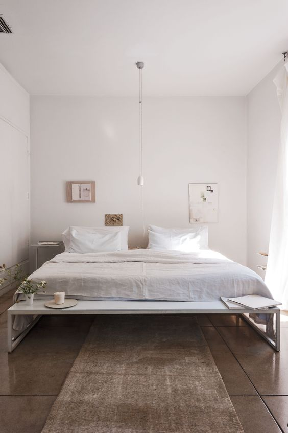low long thin white wooden bench on bed end
