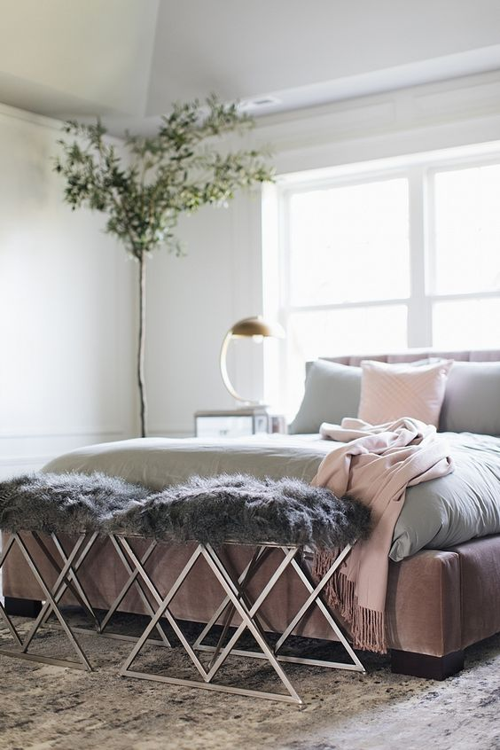 metalic bench with grey faux fur cushion