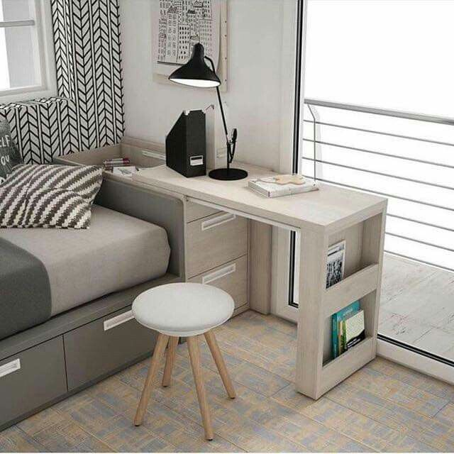 minimalist bedroom with sliding table   cabinet on the bed of the bed, storage under the bed