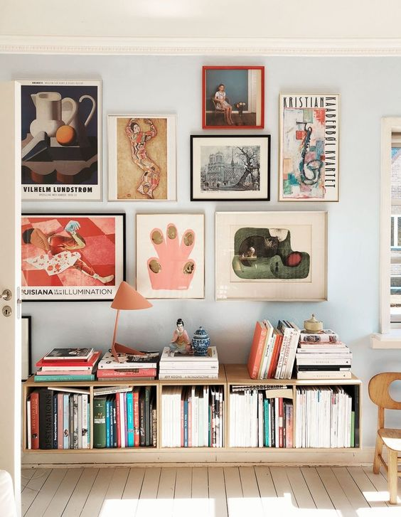 one line short low shelves on the floor under wall decorations
