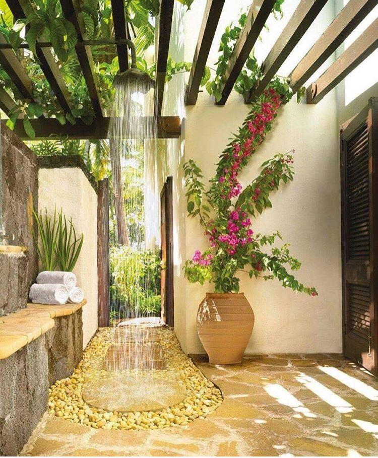 open bathroom yellow stone floor, shower from pergola, grey stone yellow stone wall, white wall,