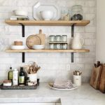 Open Shelving With Black Metal Support On White Tiles Wall Kitchen