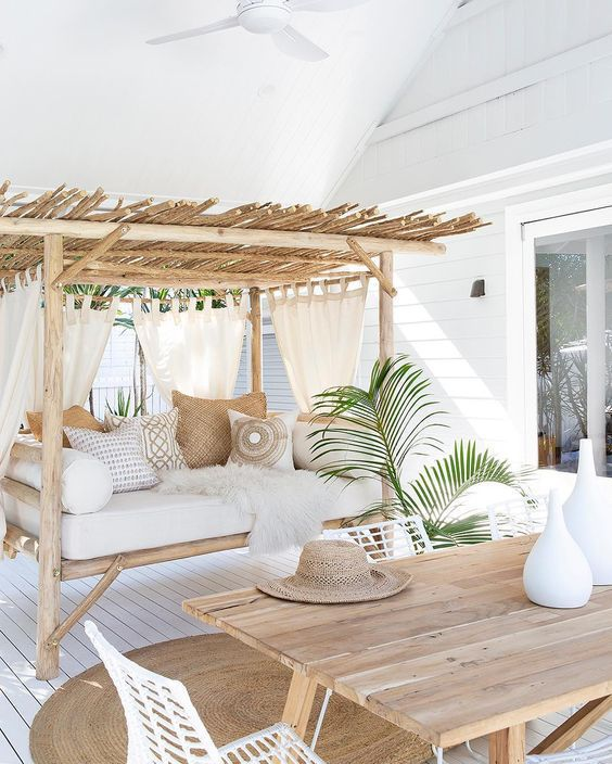 outdoor, white wooden floor, rug, wooden table, white chairs, wooden gazebo, ceiling fan