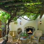 Patio With Tiles, Rattan Chairs, Round Coffee Table, Vines, Fences On Top