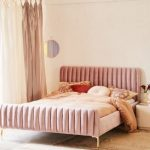 Pink Bedding On Pink Platform With Pink Fluffy Velvet Headboard And Foorboard Bed, Rug, Wooden Floor, Pink Curtain