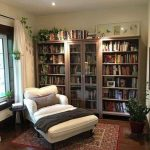 Reading Nook With Wooden Floor, White Comfortable Lounge Chair, White Curtain, Bookshelves Along The Wall