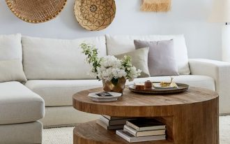 round wooden table with one side in the middle cut for shelvs