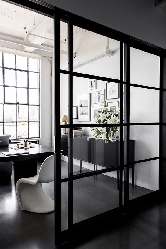 sliding glass wall with black metal frame