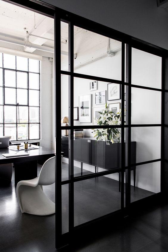 sliding glass wall with black metal frame
