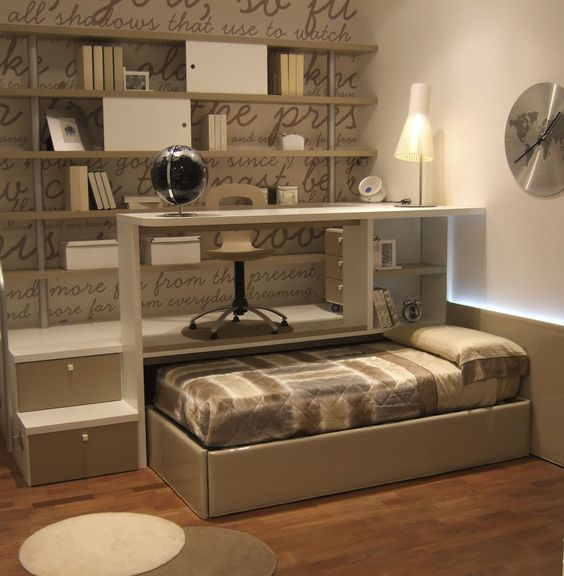 small bedroom with bed slide under the platform, study on the platform, with shelves, accent wall, wooden floor, clock, rug