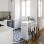 Small Kitchen With White Wall, White Cabinet, White Kitchen Top, White Marmer Bar, White Bar Stool, Glass Chandelier, Windows