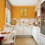 Small Kitchen With Yellow Wall, White Cabinet, White Backsplash, White Dinner Table Set, Window