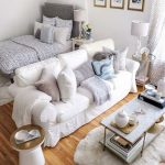 Studio Apartment With Bed, Rug, Wooden Floor, White Sofa, Coffee Table, White Curtain, Side Table, Table Lamps