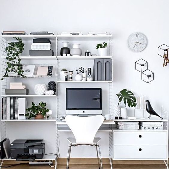study room with white wall, wooden floor, white table, white cabinet, white metal shelevs, printer, books, binders, decoration
