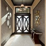 Table For Entry Way Wall Mirror Gloosy Brown Table White Shag Rug Black Framed Glass Double Front Doors Window Grey Walls Chandelier