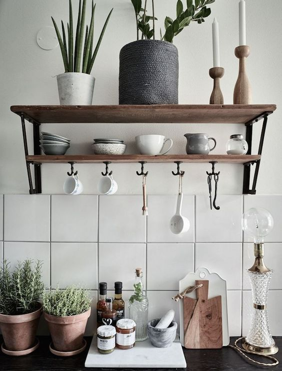 two lines of wooden open shelving in white wall with hooks under