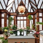 Upright Ponds Inside A Sunroom With Fish Like Shaped, Grey Tiles Rim, Brown Wall,