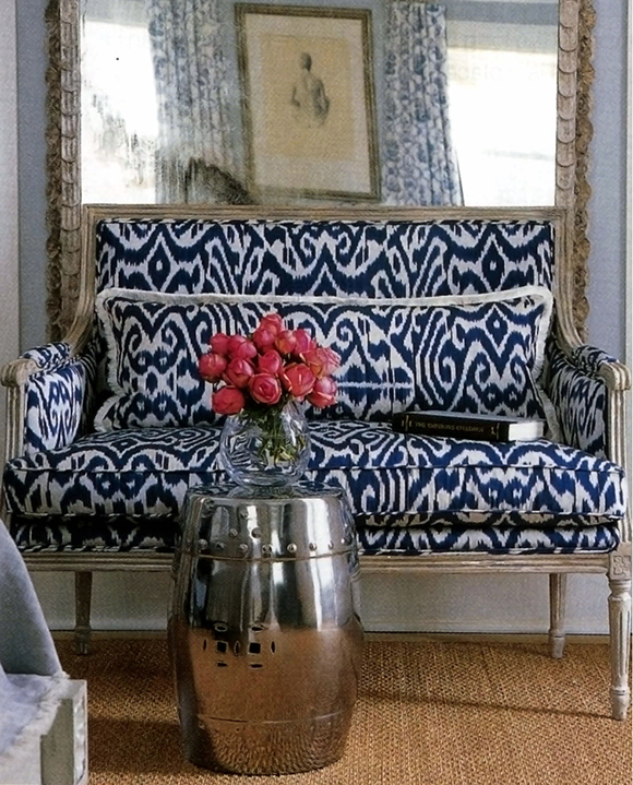 white blue ikat pattern on the cushion of a sofa with wooden legs