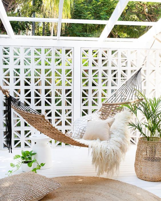white wooden floor, rug, pillow, rattan swing,