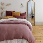 Woman Bedroom With Wooden Floor, Pink Bedding, Purple Comforter, Yellow, Red Pillows, Pendant, Standing Mirror