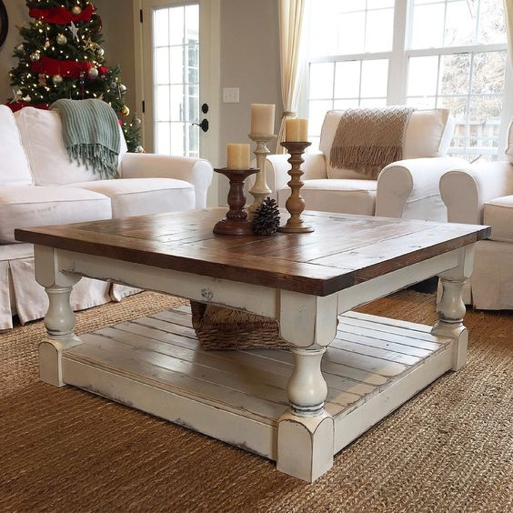 wooden coffee table with brown top, white support and shelves