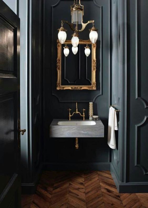 wooden floor, marble sink, golden frame mirror, chandelier, black wall