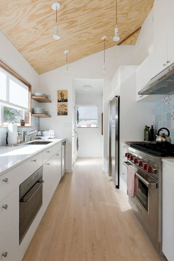 attic kitchen, wooden floor, white cabinet, white wall, wooden sloping ceiling, windows