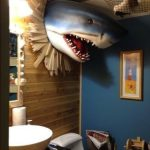 Bathroom, Blue Wall, Wooden Wall, White Sink, White Toilet With Cover, Shark Wall Decoration, Net, Wall Painting, Mirror