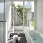 Bathroom, Grey Floor Tiles, White Wall, White Tub, Shower, Glass Sliding Door