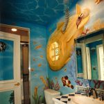Bathroom, Mural Of Underwater, White Toilet, White Cabinet Wth Diamond Top, White Sink, Windows As Submarine, Mirror