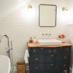 Bathroom, Patterned Floor Tiles, French Wooden Cabinet With Wooden Top, Whie Sink, White Subway Wall Tiles, Mirror, Sconces, White Tub,