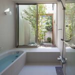 Bathroom, White Floor Tiles, White Wall Tiles, White Tub, Shower, Sliding Windows, Small Patio