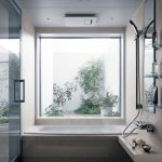 Bathroom, White Floor, White Rug, White Wall, White Tub, Shower, Floating Shelves, Mirror, Large Square Windows