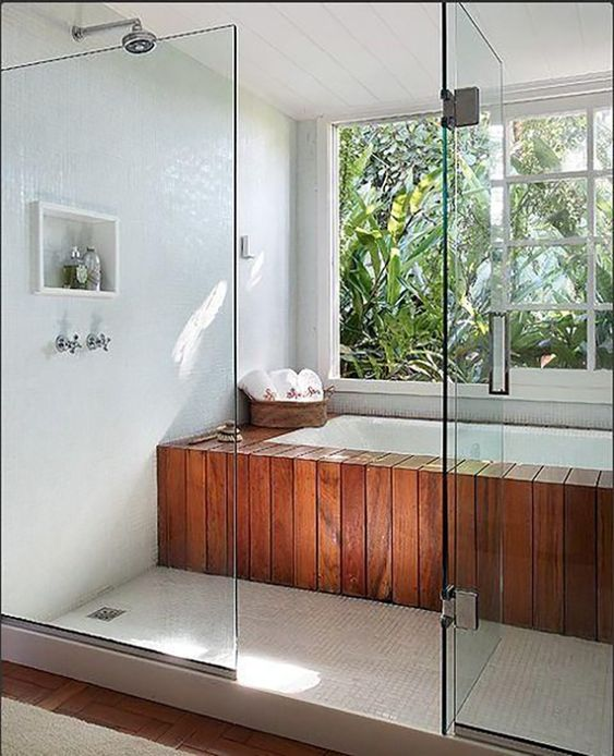 bathroom, white floor, wooden tub with white inside, white tiles wall, white wooden planks ceiling, glass partition, wooden floor