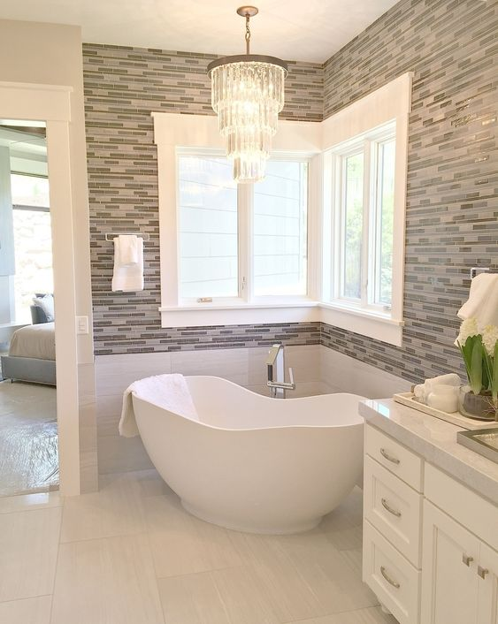 bathroom, white flooring tiles, white tub, grey wall, white cabinet, windows