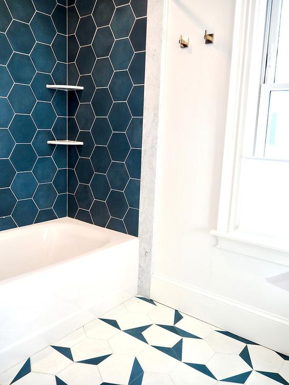 bathroom, white marble, white tub, green hexagon wall tiles, blue white geometric tiles
