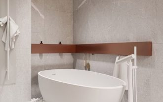 bathroom, white pebbles under white tub, white faucet, wooden floating shelves, marbled wall and floor