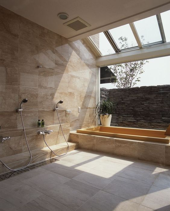 bathroom, white textured wall floor, brown marble wall tiles and tub, open wall, glass ceiling