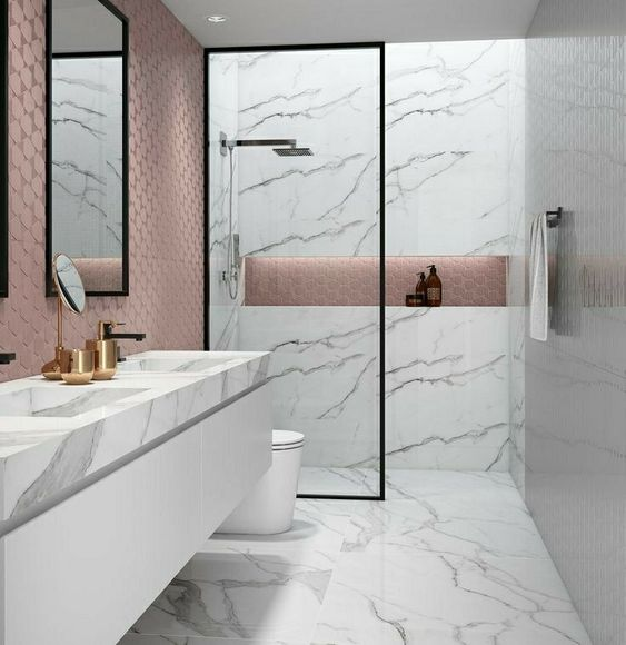 bathroom with white marble floor, marble wall on shower are, white vanity marble top, pink textured tiles on the wall