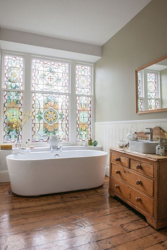 bathroom, wooden floor, wooden cabinet, white cladding, grey wall, white tub, mosaic large windows