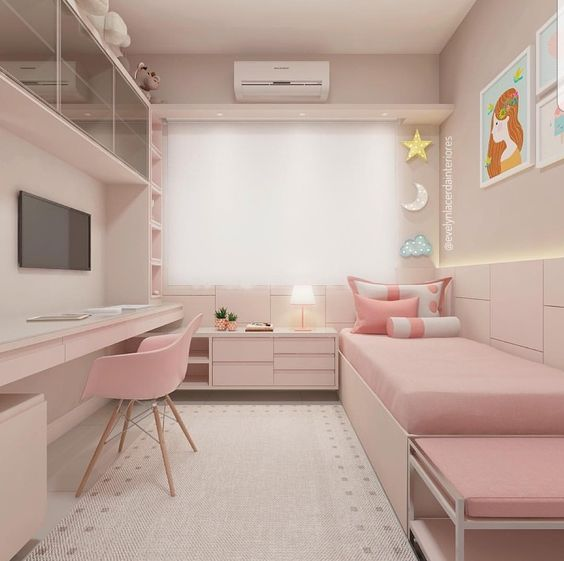 bedroom, light pink floor, pink bed platform, pink bed, pink cabinet, pink built in shelves, table, entertainment center, pink modern midcentury chair