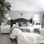 Bedroom, Whtie Wooden Floor, White Rug, White Bedding, Black Wooden Bed Platform, White Sofa, Grey White Wall, White Ceiling, Chandelier, White Wooden Bedside Cabinet