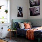 Bedroom, Wooden Floor, Grey Rug, Light Green Corner Wraparound Headboard, White Wall, Orange Metal Side Table