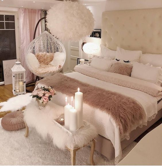 bedroom, wooden floor, white rug, white fur bench, white bedding, white wall, white fur chandelier, white swing chair
